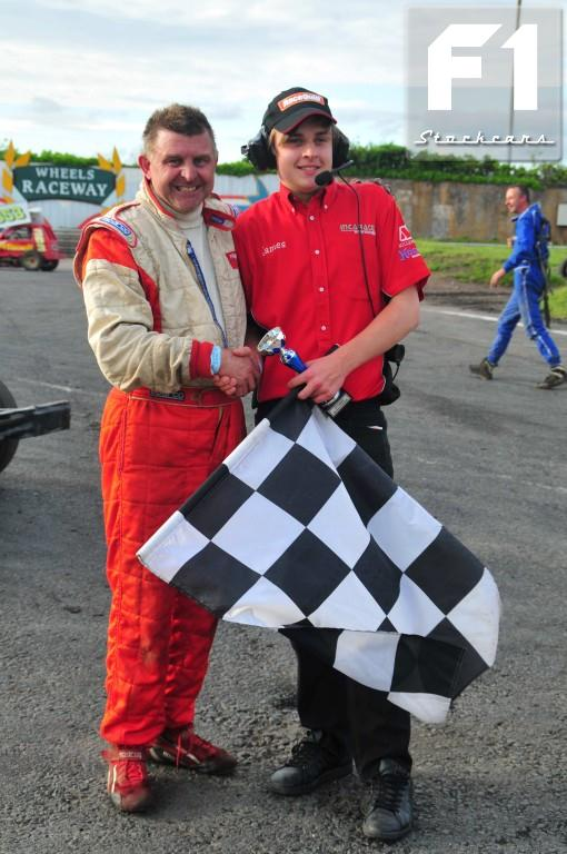 Nigel Harrhy 45 takes the trophy for his first win. Photo Steve Botham