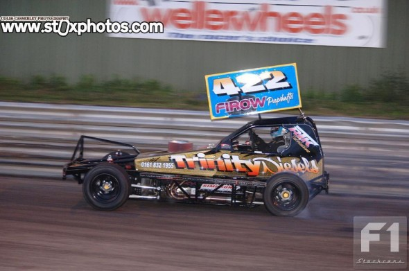 Dave Riley lighting up the rear tyres after winning the final. Photo: Colin Casserley