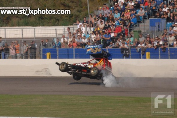 Ivan Pritchard gets his new car airborne driving over the loose halfshaft of the Wesley Schaap car.