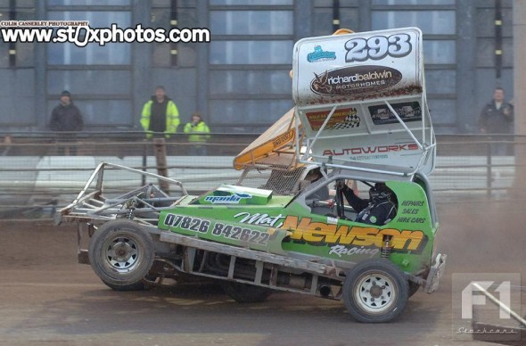 Former V8 star Eliot Smith taking the Mat Newson car for a short flight around the pit turn.