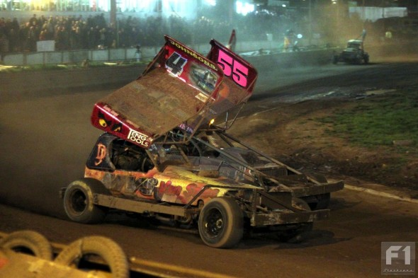 Craig Finnikin has a look up the inside of Dan Johnson on his way to victory in the Final.