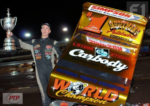 Tom displays the World Championship trophy and his new gold roof at Coventry.