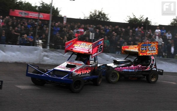Heat 2 was lively with the reds getting stuck in. Here Frankie Wainman Jnr locks onto Matt Newson.