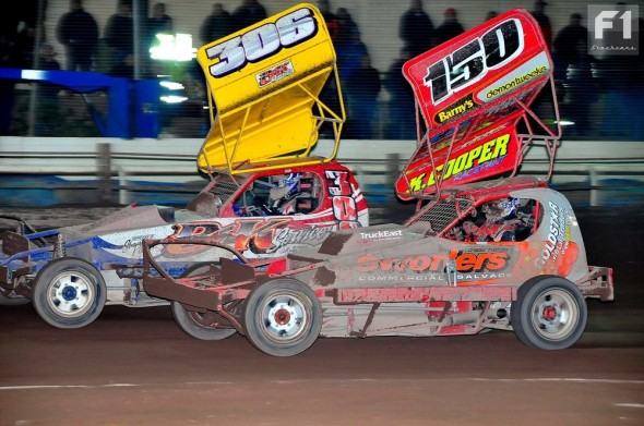 Mick Sworder on his way to Final victory passes Ian Noden